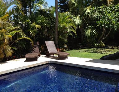 Lounge and enjoy the lovely yard and pool. Guardian Pool  fence is not shown.