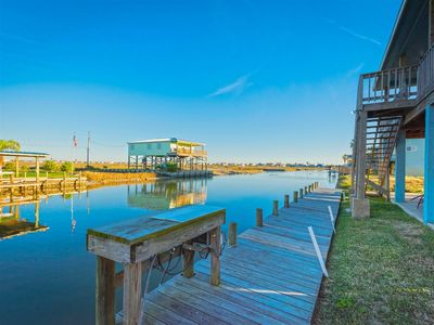 Photo for Relax on the wrap around deck with bay views to the west and canal views to the east!