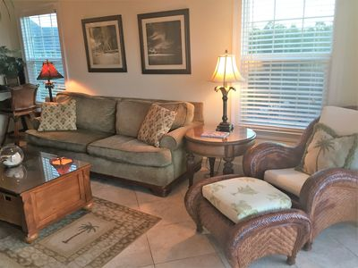 Sofa, chair and coffee table with games. 2A -End unit with great natural light