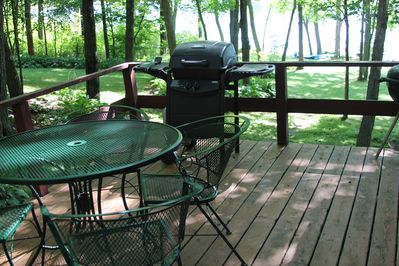 Up close view of deck and lake in the background.