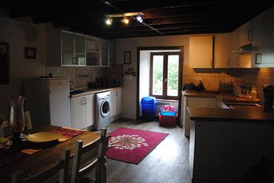 Fully equipped dining  kitchen with log burner