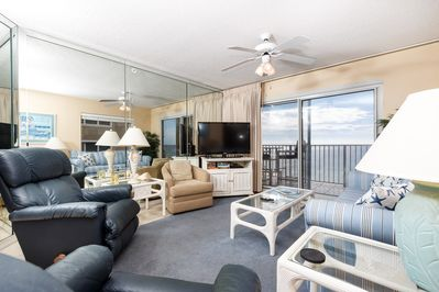 Beach front living room - This lovely condo has it all, the views are spectacular and the large flat screen TV for everyone to enjoy