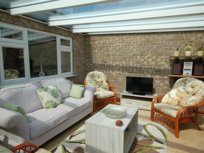 Photo for Sky View -  Enjoy panoramic roof top views from the sunny conservatory or outside deck.