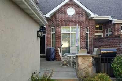 Front deck with propane grill and electric smoker.