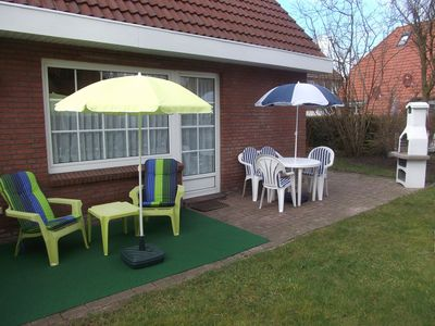 Photo for Time out in a cozy cottage with garden, quiet location, in Norddeich, North Sea