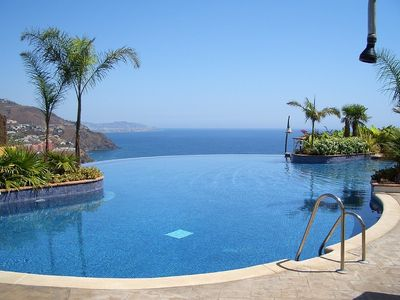 Relax beside the beautiful infinity pool