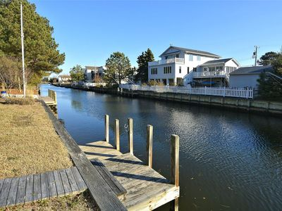 Photo for FREE DAILY ACTIVITIES!! Lovely 4 bedroom + Den,  (Two Master Bedrooms) 3.5 bath home, located on the canal, with boat dock, 2 car garage,just a short walk to the lifequarded beach.