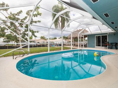 Photo for Deeply Discounted for Last Minute Travels~Heated Pool~Tiki Hut~on Water