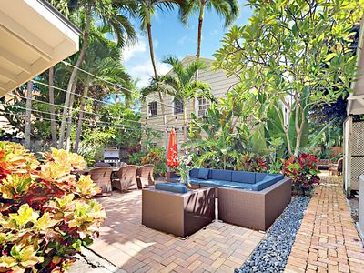 Photo for A Tropical Retreat Awaits! 1BR w/ Gorgeous Courtyard, Pool & Grill Area