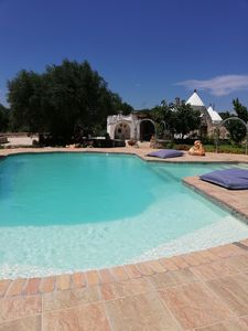 Photo for Idyllic Trullo with pool, Nestled Amongst Private Ancient Olive Groves, Close To Ostuni And Latiano