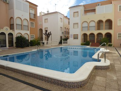 Photo for Lower apartment, popular complex on the outskirts of Torrevieja, 350 meters to the sea
