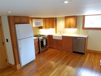 Fully furnished kitchen with brand new gas range, microwave and dishwasher.