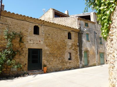 Photo for COSTA BRAVA. XIX CENTURY TOWN HOUSE RESTORED NEAR BEACHES AND GOLF COURSES