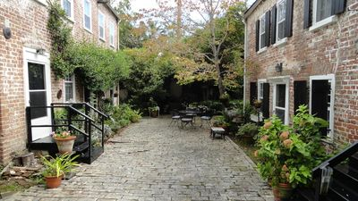 Photo for 2 Bedroom Cottage in the center of town! Free Parking and Private Courtyard!
