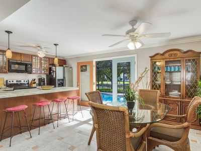 Photo for NEW LISTING! Spacious, waterfront home w/ an enclosed private pool & dock