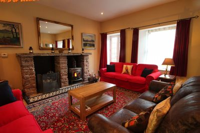 Spacious yet cosy sitting room with woodburning stove.
