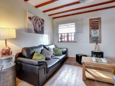 Photo for Cosy apartment in villa for four people with WIFI, TV and parking