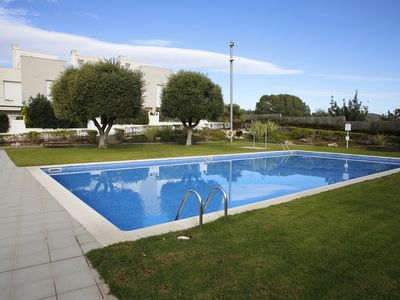 Photo for AT083 CREIXELL: Terraced house for 10 people with communal pool