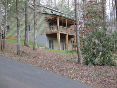 Large private, paved driveway leads to entrance