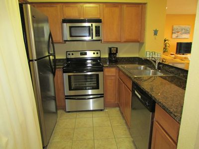 Beautiful kitchen with stainless steel appliances and granite counter tops