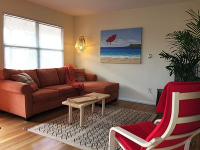 Spacious living room with flat sceen TV