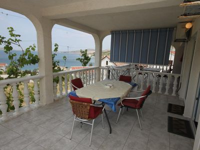 Photo for Two bedroom apartment with terrace and sea view Metajna, Pag (A-6426-c)