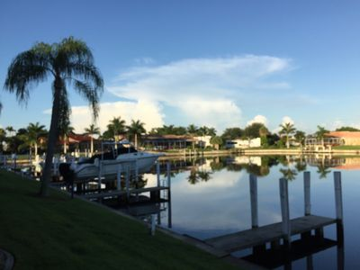 Photo for Surreal sunsets; huge lanai; private dock. Walk or bike to just about everything
