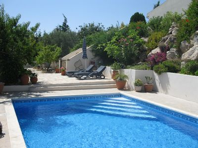 Photo for A hillside retreat with a large pool and set in extensive gardens