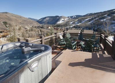 Stunning views of Vail Mountain slopes on oversized deck with hot tub & fire pit