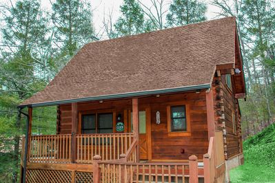 True log cabin on a cul-de-sac about a mile from the main Pigeon Forge Parkway.
