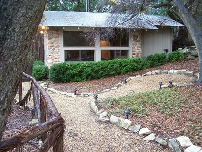 View of Historic Cabin, Rustic Cedar Fence, Private Yard, and Lighted Walkways