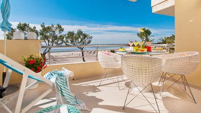 Photo for Charming apartment on the beach with fantastic views in Puerto de Alcudia