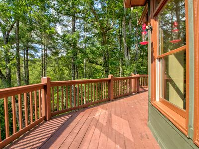 Photo for Secluded forest home w/ private hot tub, decks & shared pool/tennis - 2 dogs OK!