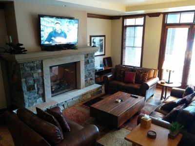 New 60' TV with sound bar and comfortable leather couches.