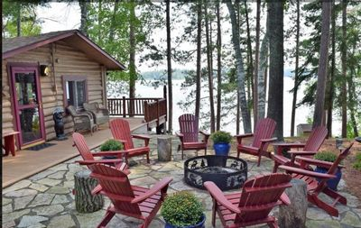 Fire Pit Over Looking Lake and Large Pines with Grilling Area