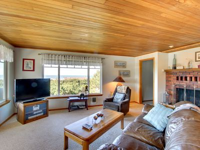 Photo for Dog-friendly home w/spectacular views & close to lake + 1 block to the beach!