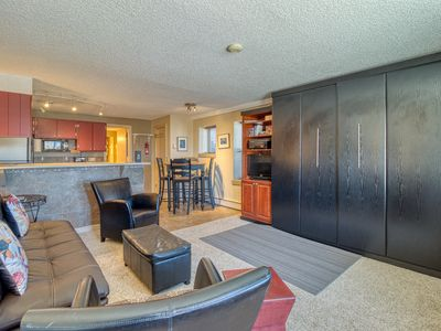 Photo for Cozy mountain view condo w/ patio - on bus route, great for skiing/boating!