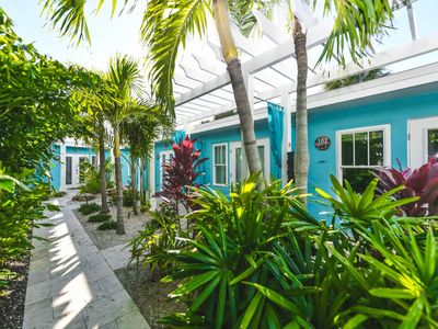 Photo for Tropical Breeze Resort - Full Kitchen - Sleeps 4 - 1/2 Block to Siesta Key Beach and Village District. INCLUDED: Daily Housekeeping, Bikes, 2 Pools/1 Spa, Beach Chairs, Beach Towels, WiFi, Parking , Games, BBQs and More!