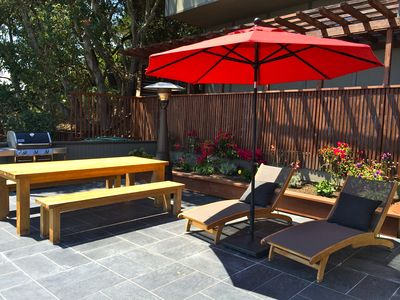 Terrace with big table, sun beds and barbecue