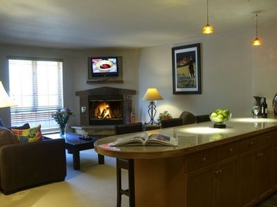 Living room with gas fireplace and full kitchen with all utensils.