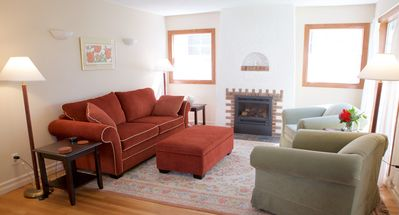 Main floor living room with gas fireplace.