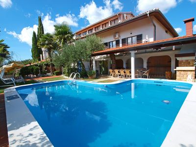 Photo for This 6-bedroom villa for up to 12 guests is located in Plovanija and has a private swimming pool, ai