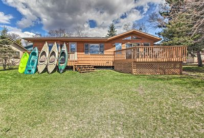 The home boasts a spacious deck facing the lake and offers kayaks for your use.