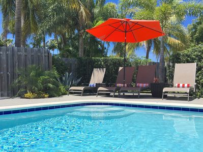 Enjoy cold drinks by the private heated pool every day.