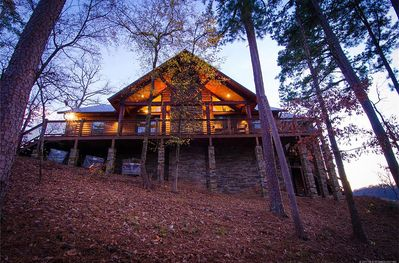 Front view of the cabin with the surrounding forest.