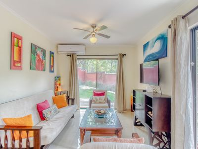 Photo for Colorful condo w/ shared pool & central AC, less than two blocks from the beach