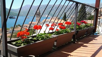 Photo for Spacious, sunny apartment with amazing sea and mountain views