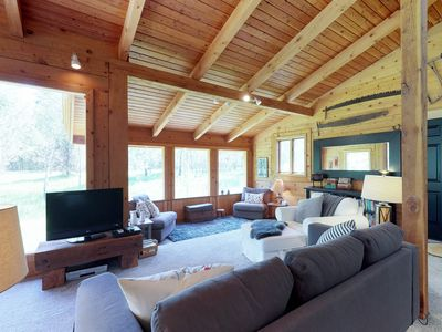 Photo for Quiet, tree-lined property with a gorgeous deck and an expansive yard!