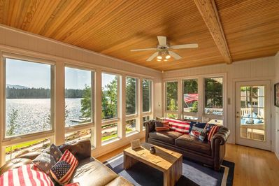 Sun room leads out to the large deck with seating & BBQ