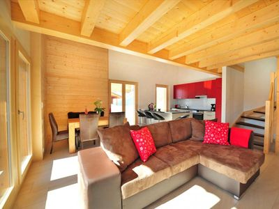 Photo for Surface area : about 105 m². Living room with settee, stove, satellite TV. Bedroom with double bed